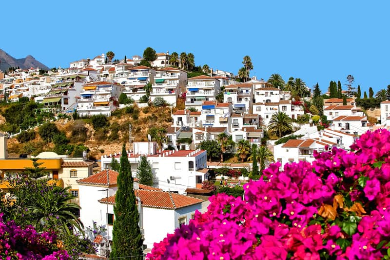 Things to do in Nerja, Historic Center, Malaga Province, Costa del Sol, Houses at and on the Hill, Balcony of Europe, Flowering Bougainvillea Pine, Date Palms