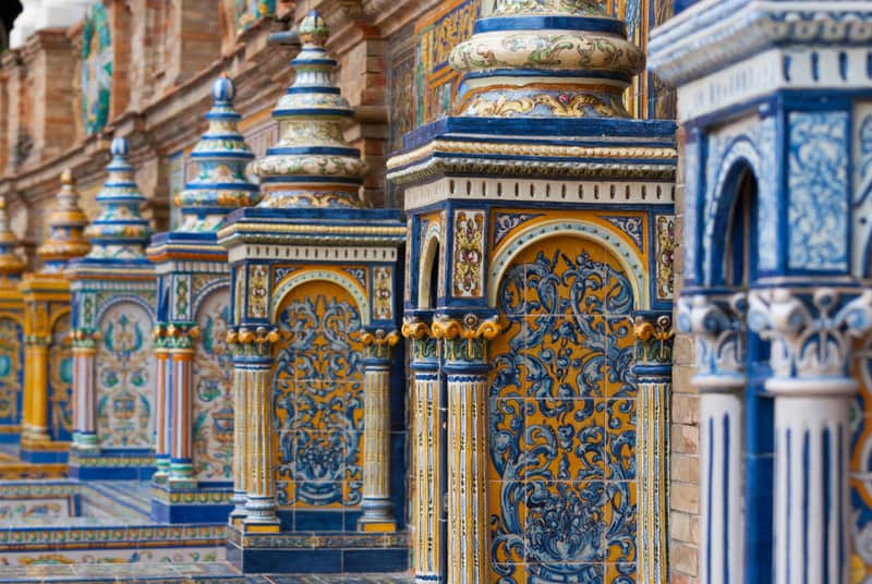 Detail of the tiled benches at the Plaza de España in Sevilla, Spain. Designed by Aníbal González for Seville's 1929 Ibero-American Expo in Andalusian regionalist style, the Plaza contains a series of Spanish glazed-tile alcoves that depict historical scenes form every province in Spain.