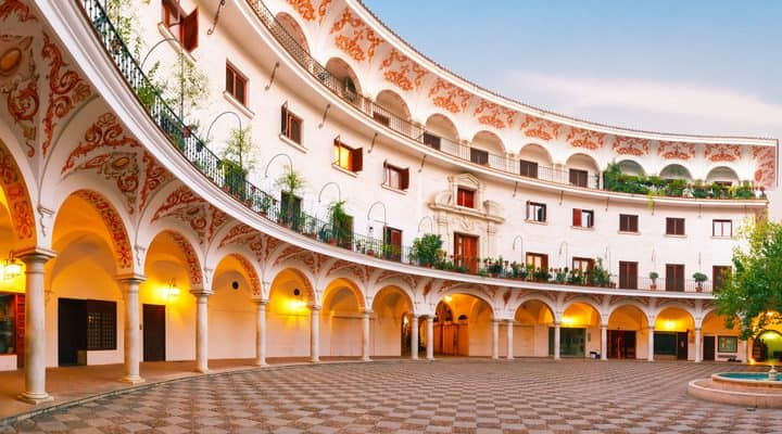 Panorama of picturesque square plaza del Cabildo in the morning, Seville, Andalusia, Spain