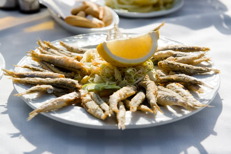 Plate of deep fried anchovies with lemon for lunch in Cordoba, Spain