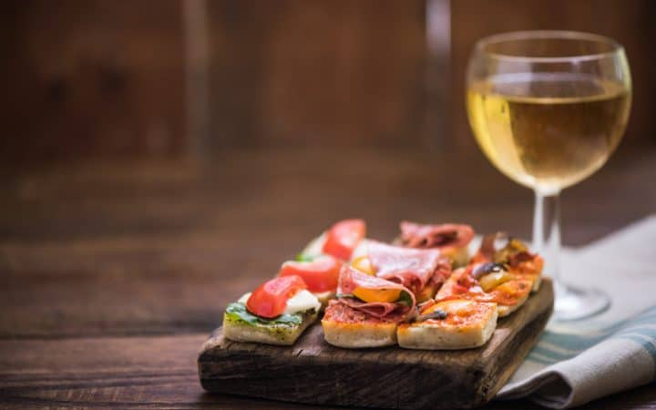 tapas and wine served on wooden board