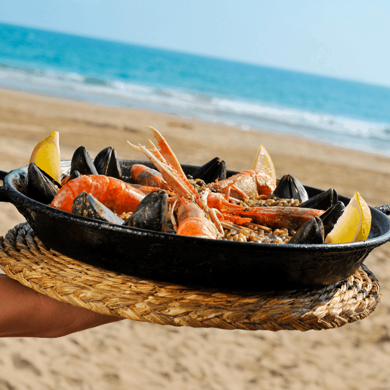 Traditional Paella on the beach in Seville, Spain