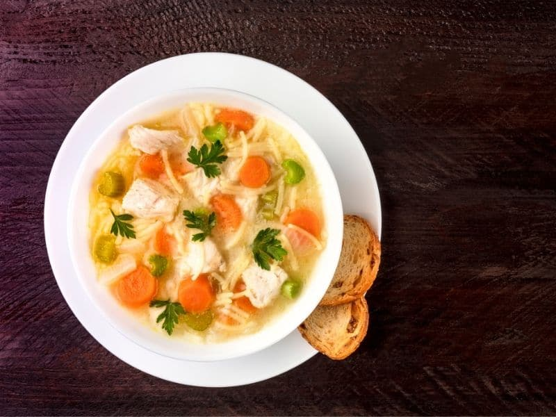 Chicken soup with noodles, overhead photo