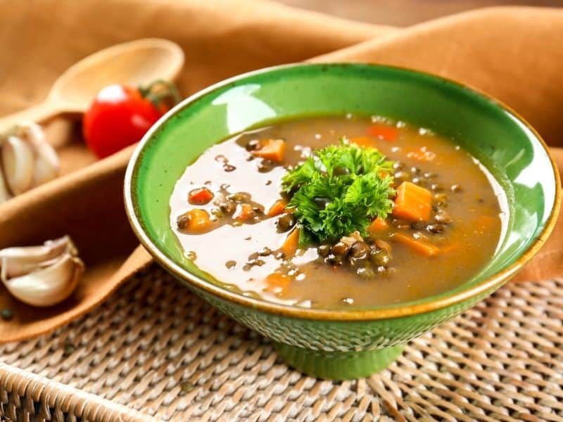 spanish lentil soup with parsley topping